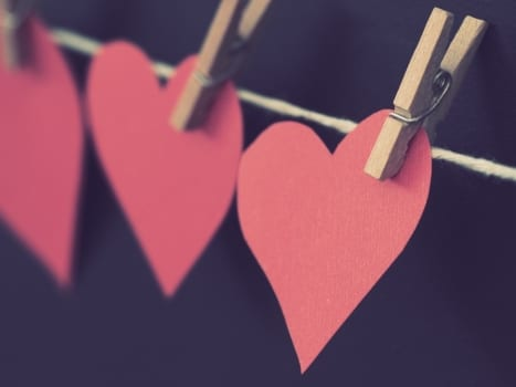 photo of red heart shaped paper hanging on rope 786799