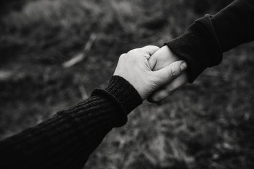 black and white photo of holding hands 735978 003